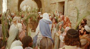 Jesus rides into Jerusalem